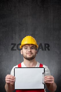 Worker showing a blank clipboard