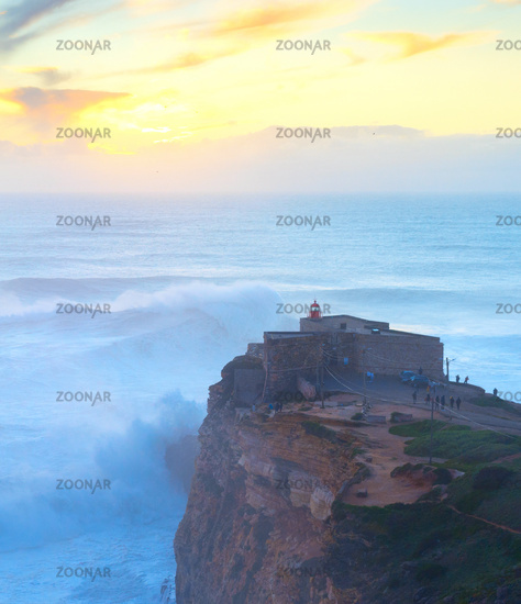 Lighthouse  Nazare Portugal surfing waves