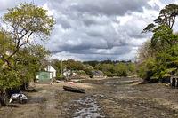 HELSTON, CORNWALL, UK - MAY 14 : Low tide in Helston, Cornwall on May 14, 2021. Unidentified people