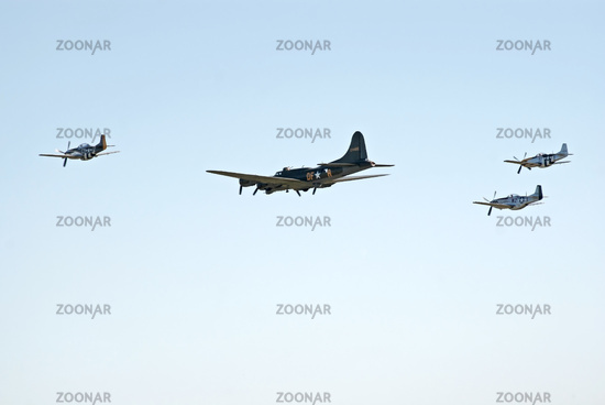 B-17 escorted by three P-51s