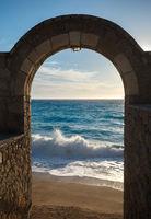 Seashore through the arch door