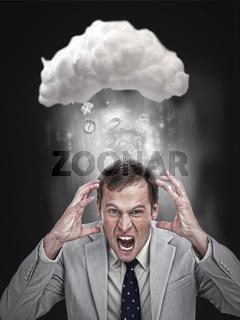 Businessman stressing out under a cloud