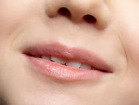 Human mouth and nose. Closeup macro portrait of young female teenager part of face