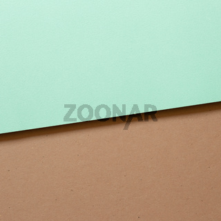 Mint blue and brown layered color paper background. top view