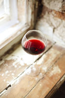 One wineglasse with red wine during party