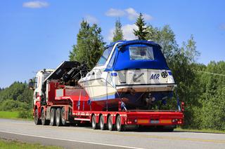 Scania Semi Trailer Transports Recreational Boat