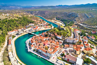 Town of Obrovac and Zrmanja river panoramic aerial view