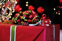 Christmas background with various of gifts and green fir tree