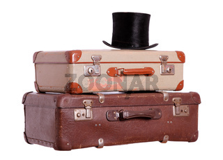 old suitcases with black hat