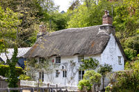 HELSTON, CORNWALL, UK - MAY 14 : Thatched cottage in Helston, Cornwall on May 14, 2021