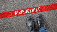 Red line on asphalt - Risk area in german - Risikogebiet