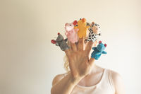 Woman hand wearing five finger puppets close up