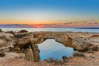 Famous stone Sin Bridge at sunrise in Ayia Napa Cyprus