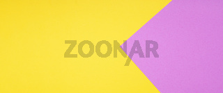 yellow and pink two color paper background in web banner format
