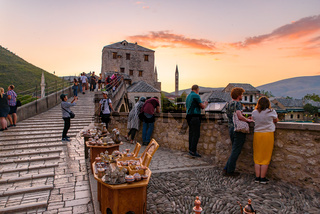 People on the old bridge watching sunset in Mostar, Bosnia and Herzegovina