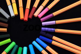Color Pens in form of love on black background