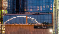 Reflection of the Korean Veterans bridge in office buildings window as dusk falls in Nashville