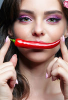 Female with spicy hot red cayenne chilli pepper