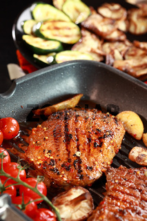 Delicious steak with grilled vegetable and mushrooms