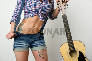 Attractive Woman's Torso Holding Guitar