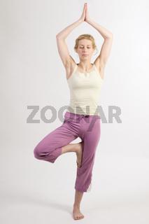 yoga tree two closed eyes