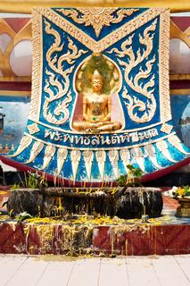 Golden statue of Buddha in meditation. Thailand
