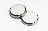 Button cell battery or coin cell isolated on white background