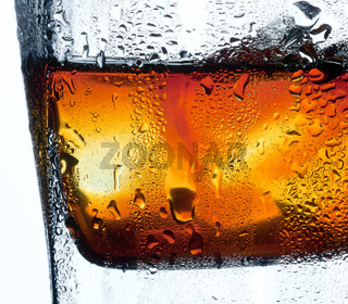 Closeup misted glass of whiskey