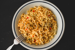 Noodles with vegetables on a plate. horizontal view from above