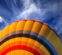 Hot air balloon on blue sky with clouds at nice sun evening