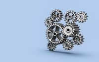 Metallic Gears on Blue Background with Copy Space