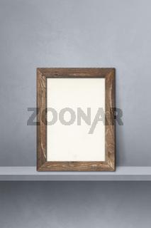 Wooden picture frame leaning on a grey shelf. 3d illustration. Vertical background