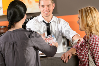 Female customers paying by cash EUR bar