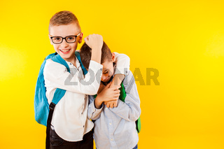 The little schoolboys have fun and show their strength