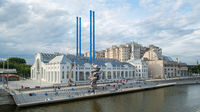 Moscow, Russia - August 24, 2021: Hydroelectric power station on Bolotnaya Embankment with monumental sculpture work, Big Clay number 4 made by the Swiss artist Urs Fischer