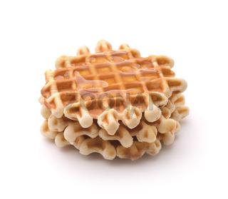 Freshly baked homemade belgian waffles with honey