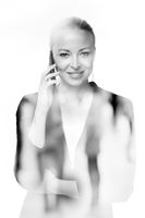 Portrait of beautiful young caucasian woman using mobile phone.