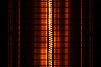 Close up of an electric heater coil with grill protection