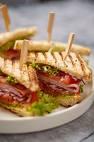 Appetizing fresh and healthy grilled club sandwiches with ham and cheese
