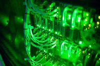 Closeup of computer server with colorful lights and wires