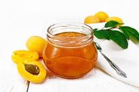 Jam apricot in jar on white board