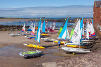 NORTH BERWICK, EAST LOTHIAN, SCOTLAND - AUGUST 14 : Brightly coloured yachts at North Berwick harbour in Scotland on August 13, 2010. Two unidentified people