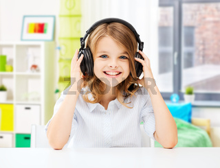 happy smiling girl with headphones at home