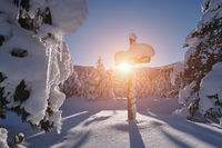 wooden cross covered with fresh snow at beautiful fresh winter morning
