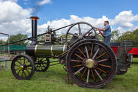 RUDGWICK, SUSSEX, UK - AUGUST 27 : Traction engine at Rudgwick Steam Fair in Rudgwick Sussex UK on August 27, 2011. Unidentified man.