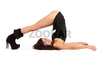 Sexy woman practicing yoga. Wears beautiful boots