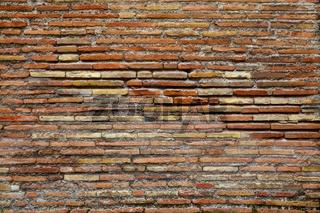 Ancient brickwork of flat roman bricks