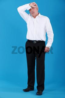 senior businessman looking very tired