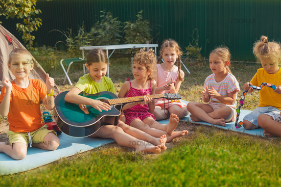 the children have a great time together in the backyard
