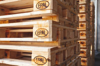 Kyiv, Ukraine - September 20, 2019: Close up of Piles of EPAL pallets